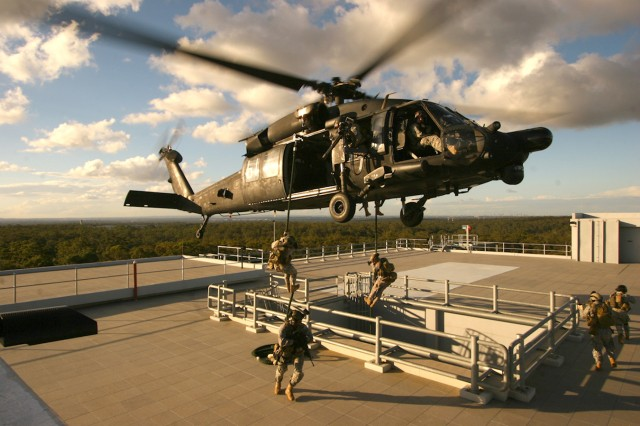Special Operations Soldiers fast-rope from an MH-60 from the 160th Special Operations Aviation Regiment  (SOAR) to an objective.