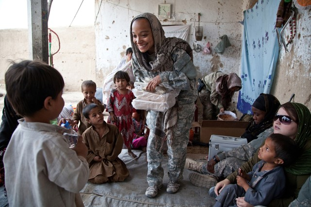 A team of Cultural Support Team Soldiers meet with local women and children while on a deployment in Afghanistan.