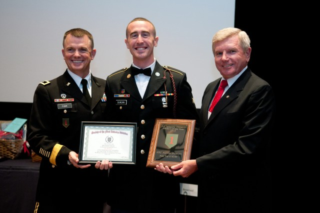 Maj. Gen. Paul E. Funk II, 1st Inf. Div. and Fort Riley commanding general, left, and Retired Lt. Gen. Robert E. Durbin, president of the Society of the 1st Infantry Division, right, recognize Spc. Aaron Duncan, a combat medic in 4th Sqdn., 4th Cav. Regt., 1st ABCT, as the 1st Inf. Div.'s Soldier of the year Aug. 3, 2013, in Jacksonville, Fla., during the 95th annual Society of the 1st Infantry Division Reunion. Duncan won a division-wide competition earlier this year.