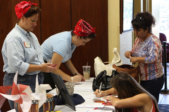 Jackie Crogan and Tina Tucker dressed as Rosie the Riveter for the Fort Rucker Community Spouses Club Super Sign-Up in 2011. This year's membership drive is Aug. 15 at The Landing's ballroom from 10 a.m. to 1 p.m.