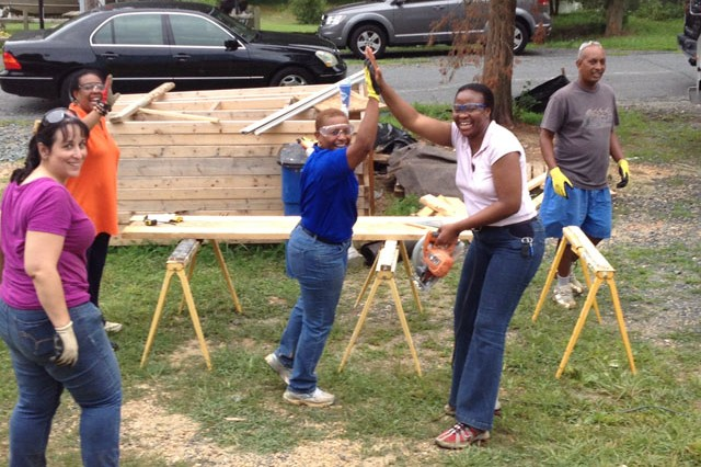 (From left) Melissa Schutz of ATEC; Sheryl Coleman of ARL; Monique Ferrell,  the spouse of APG Senior Leader, Maj. Gen. Robert Ferrell; Capt. Ijeoma Okoye, USAPHC; and Fepahi Gyesus, a local volunteer, enjoy a light moment while working on the Team APG Women's Home Build project with the Harford Habitat for Humanity in Aberdeen Aug. 3.