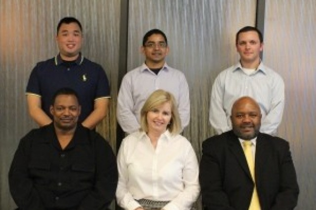 Product Director Communications Security's Key Management Infrastructure Network Integration Evaluation team: (standing, from left to right) Ryan Lem, Imran Rashid and William Wiesner; (sitting from left to right) Patrick Gordon, Diane Merla and Ralph Jordan.