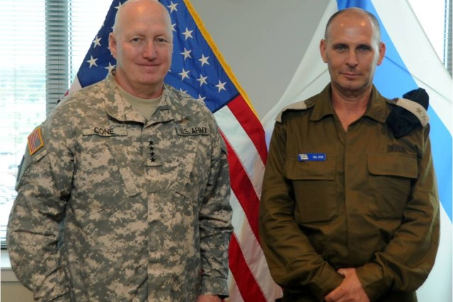 Gen. Robert W. Cone, commanding general of U.S. Army Training and Doctrine Command, (left)  and Maj. Gen. Guy Zur, chief of the Israel Defense Forces, participate in the FBAT XXII, July 22, 2013 at the TRADOC headquarters on Fort Eustis, Va.