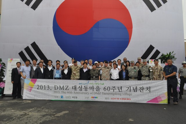 "TAESEONGDONG, South Korea "" Col. Michael J. Lawson, commander of 210th Fires Brigade, 2nd Infantry Division, participates in the Taeseongdong Village 60th Anniversary Celebration in the Joint Security Area of the Demilitarized Zone, South Korea August 2, 2013. The ceremony marked the establishment of the small village, known as ""Freedom Village,"" after the signing of the Korean War Armistice in 1953. Attendees included senior leaders from Gyeonggi-do Province, the United Nations Command Military Armistice Commission, the Neutral Nations Supervisory Commission, 2nd Infantry Division, and delegates from several embassies. The event included performances by the Taeseongdong Elementary School percussion band and the 1st Infantry Division Band. It ended with participants joining the citizens of Taeseongdong to build a rice cake tower of peace. The village is a symbol of the success of the ROK-U.S. Alliance that was forged during the Korean War and has grown stronger over the last 60 years. (U.S. Army photos by Capt. Kelly E. McKenzie, 210th Fires Brigade Public Affairs Officer/Released)."