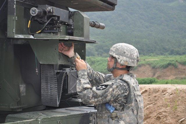 "CHIPORI RANGE, South Korea "" Staff Sgt. Marcus Sanchez, from San Antonio, Texas, avenger crewmember master gunner assigned to E Battery, 6th Battalion, 52nd Air Defense Artillery Regiment, attached to 6th Battalion, 37th Field Artillery Regiment, 210th Fires Brigade, 2nd Infantry Division, changes ammunition on the M3P .50 caliber machine gun during a qualification exercise at Chipori Range, South Korea Aug. 7, 2013. The exercise was to qualify Soldiers on the Avenger Gunnery Program to enhance the unit's readiness to fight tonight to deter aggression against South Korea. (U.S. Army photo by 210th Fires Brigade public affairs specialist/Released)."