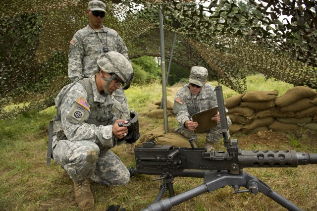 U.S. Army Pvt. Braser Sestoso, assigned to 1st Battalion, 4th Infantry Regiment, corrects head, space, and timing on a M2, 50 caliber machine gun during the Expert Infantryman Badge testing Aug. 17, 2013 at the Joint Multinational Readiness Center's, Hohenfels Training Area, Germany.