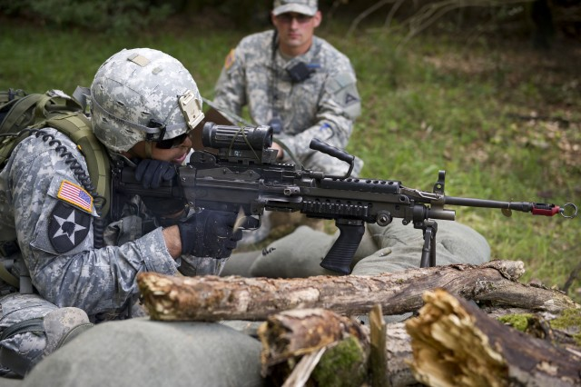U.S. Army Soldier assigned to 1st Battalion, 4th Infantry Regiment, fires the M249 squad automated weapon (SAW) during the Expert Infantryman Badge (EIB) testing, Aug. 08, 2013 at the Joint Multinational Readiness Center's, Hohenfels Training Area, Germany