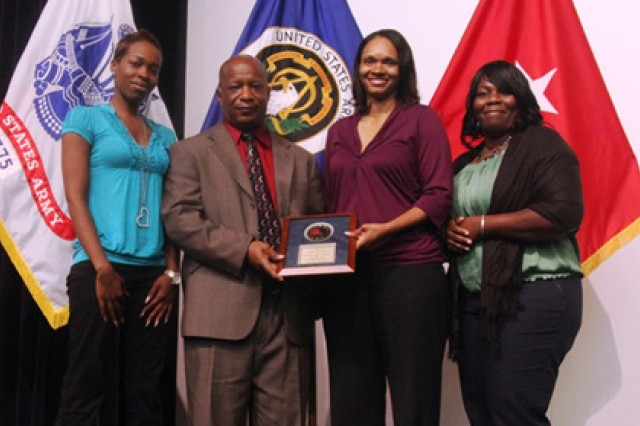 (From left) Maia Green, Joe Pearson, Tia Cox and Linda Darden pose with the award they received from Department of the Army Headquarters G-8 for their 100 percent success rate on Item Unique Identification number registry.