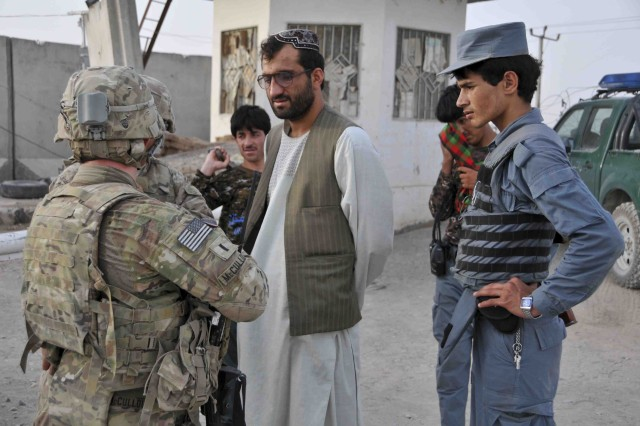 "KANDAHAR AIRFIELD, Afghanistan -- U.S. Army 1st Lt. Ryan McCullough (left) with 2nd Platoon, Troop P (Palehorse), 4th Squadron, Combined Task Force Dragoon, speaks with Afghan Uniformed Police during a reconnaissance mission Aug. 6, 2013 at Kandahar, Afghanistan. Troops with ""Palehorse"" Troop talk with local community members and local police in order to forge relationships and eliminate enemy threats."