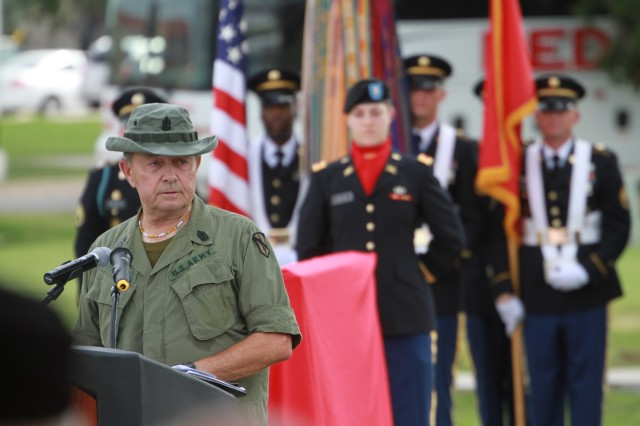 Retired Sgt. Maj. Paul Hanson speaks to Air Defense Artillery Soldiers from the Vietnam-era and today's Army, at a memorial unveiling ceremony, Aug. 9, 2013, at Fort Sill's (Okla.) Constitution Park.