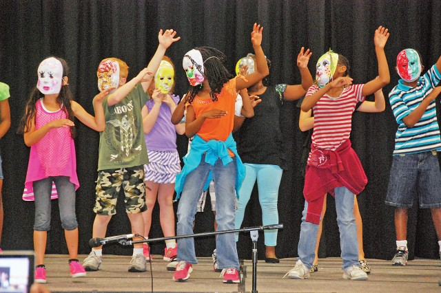 "The ""Golden Werewolves,"" a group of SAS campers, dance to ""Thriller"" during the camp's finale, a performance called, Big Red Fun Summer Jam, Aug. 2 at the School Age Center, Fort Riley, Kan."