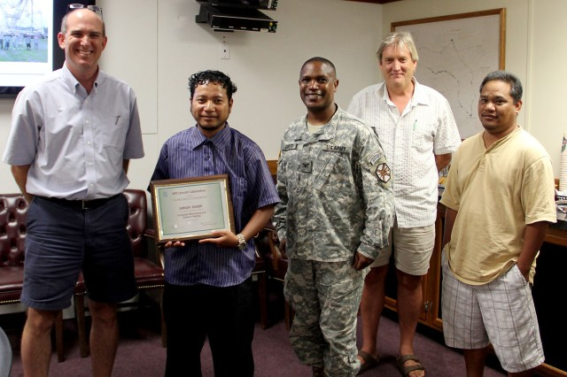 U.S. ARMY KWAJALEIN ATOLL, Republic of the Marshall Islands (Aug. 10, 2013) -- Lebon Joash, second from left, receives his completion certificate for his 10-week MIT/LL internship. Pictured from left is Gabe Elkin, Col. Nestor Sadler, Bruce Kopp and Ranny Ranis.