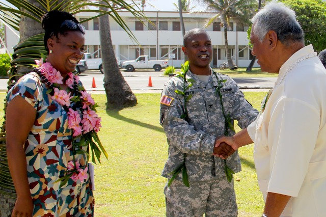 U.S. ARMY KWAJALEIN ATOLL, Republic of the Marshall Islands (Aug. 10, 2013) -- Col. Nestor Sadler, right, and wife, Monica, greet Kwajalein Iroij/Senator Michael Kabua after the Assumption of Command ceremony.