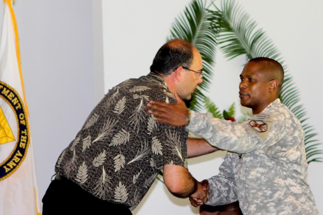 U.S. ARMY KWAJALEIN ATOLL, Republic of the Marshall Islands (Aug. 10, 2013) -- Col. Nestor Sadler, right, shakes hands with Thomas Webber, after his speech at the Assumption of Command ceremony Aug. 2.