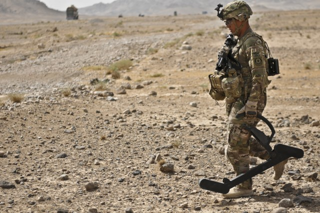 A U.S. Army Soldier with Engineer Troop, Regimental Support Squadron, Combined Task Force Dragoon, uses a lightweight, portable, handheld device called a goldie to detect IED components Aug. 7, 2013, at Kandahar, Afghanistan. Flores and his platoon conducted a route clearance package, a mission to ensure specified roads of travel are clear of IEDs. (U.S. Army Photo by Spc. Joshua Edwards)