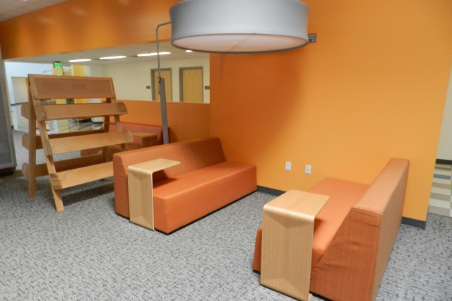 "This section of the library at Colonel Smith Middle School at Fort Huachuca, Ariz., demonstrates the interior colors and furniture styles critics praised in the June 2013 issue of ""School Planning & Management"" magazine. The publication also announced Colonel Smith Middle School as the grand prize winner of the Education Design Showcase, 2013."