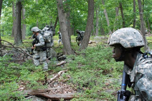 Spc. Benjamin Lewis (right) and other Soldiers move tactically over hilly terrain during the New York Army National Guard's annual Infantryman Transition Course here Aug. 7, 2013. The New York Army National Guard's 106th Regional Training Institute, or RTI, holds the course so Soldiers can become fully-qualified members of infantry units. Soldiers from all Army components can attend the course.  Lewis and 18 other Soldiers graduated from the course Aug. 10. Lewis, of Roosevelt, N.Y., belongs to D Company, 1st Battalion, 69th Infantry, New York Army National Guard.