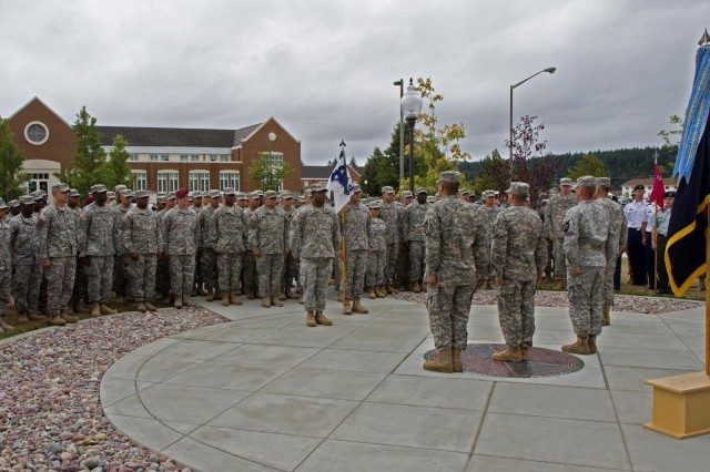 (center, L to R) Pvt. Marvin Frisby, 2nd Stryker Brigade Combat Team; Spc. Benjamin Rubino, 201st Battlefield Surveillance Brigade; and Sgt. Larry Blais, 3rd Stryker Brigade Combat Team; stand in front of Soldiers from their respective brigades, Aug. 2, at the 7th Infantry Division headquarters, Joint Base Lewis-McChord, Wash. Frisby, Rubino, and Blais were recognized as the Bayonet Soldiers of the Month for various actions and presented a certificate and commanders coin from Maj. Gen. Stephen R. Lanza and Command Sgt. Maj. Delbert Byers, the division's commanding general and command sergeant major.