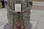 Soldier receives recognition after delivering baby at gate