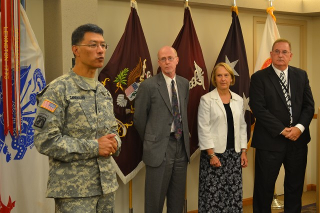 Maj. Gen. Joseph Caravalho Jr., commanding general of the U.S. Army Medical Research and Materiel Command and Fort Detrick, honored three USAMRMC senior research scientists for their years of dedication and service to the command during a ceremony at USAMRMC headquarters Aug. 8.