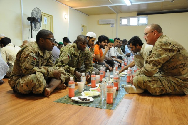 Sergeant Richard Blevins (right), 115th Military Police Detachment, talks with Sgt. Marcus Lewis (left) and Pvt. Munir Muhammed, both with Combined Task Force Dragoon, at the Kandahar Islamic Center Aug. 3, 2013. The Soldiers are deployed in support of Operation Enduring Freedom and observed Ramadan with prayer and an iftar during the Muslim holy month. An iftar is a breaking of the fast meal. (U.S. Army photo by Staff Sgt. Mark Albright)