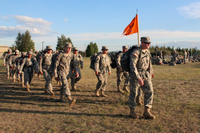 Soldiers of the 176th Signal Company, 1st Stryker Brigade Combat Team, 25th Infantry Division step off on a 25-mile road march on Fort Wainwright, Alaska Aug. 8. (U.S. Army photo by Sgt. Michael Blalack, 1/25 SBCT Public Affairs)