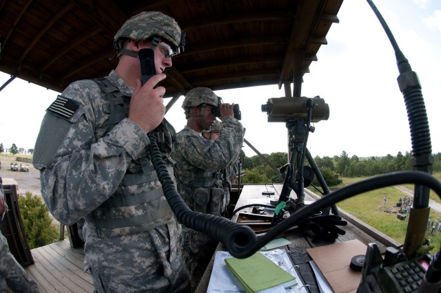 2nd Lt. Robert J. Beery, of Tinton Falls, N.J., uses a radio during a call for fire mission while Sgt. Michael A. Ruffin, of Cleveland, Ohio, uses binoculars to spot mortar rounds as they land on an impact area on Fort Bragg, N.C., Aug. 9. The mortarmen, with the 82nd Airborne Division's 1st Brigade Combat Team, fired more than 30 rounds as part of a professional development training session for leaders in Headquarters and Headquarters Company, 1st Battalion, 504th Parachute Infantry Regiment. (U.S. Army photo by Staff Sgt. Mary S. Katzenberger)