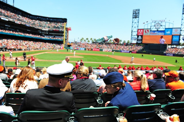 PRESIDIO OF MONTEREY, Calif. -- Navy Cmdr. Sean Cooney and Senior Master Sgt. Carol Sligh enjoy the excellent seats provided by Coca-Cola and the San Francisco Giants.