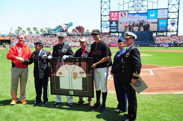 PRESIDIO OF MONTEREY, Calif. -- Service members from the Defense Language Institute Foreign Language Center are honored by the Coca-Cola company and the SF Giants during a pre-game ceremony on July 21.