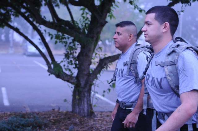 Father and son meet during physical training to conduct a road march around North Fort, July 7. Sgt. 1st Class Fernando Perez, platoon sergeant, 14th Engineer Battalion, 555th Engineer Brigade, and Spc. Jerae Perez, intelligence analyst, 2nd Squadron, 1st Cavalry Regiment, 4th Brigade, 2nd Infantry Division, are currently on active duty and both are stationed here.