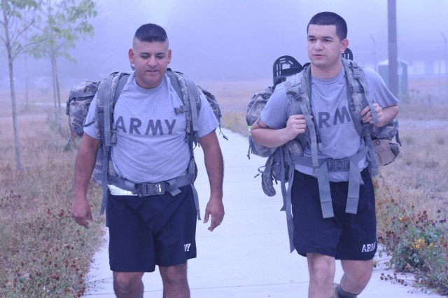 Father and son meet during physical training to conduct a road march around North Fort, July 7. Sgt. 1st Class Fernando Perez, platoon sergeant, 14th Engineer Battalion, 555th Engineer Brigade and Spc. Jerae Perez, intelligence analyst, 2nd Squadron, 1st Cavalry Regiment, 4th Brigade, 2nd Infantry Division, are currently on active duty and both are stationed here.