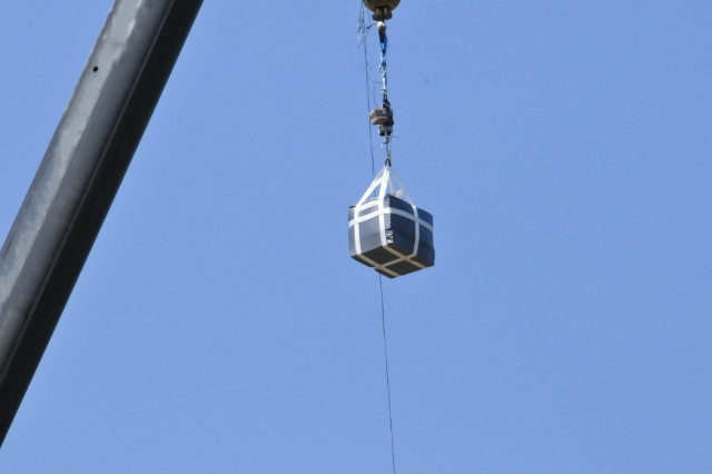 The Enhanced Speed Bag system multipurpose cargo bag is suspended from 100 feet and prepared to drop, July 16, 2013, at Fort A.P. Hill, Va.