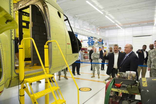 Under Secretary of the Army Joseph W. Westphal conducts an industry visit with Boeing in Ridley Park, Pa., August 14, 2013. Westphal visited the facility to gain situational awareness and tour the newly refurbished manufacturing facility for the CH-47F. The Army's deliberate efforts to maintain a relationship with industry are critical to ensuring the production of capabilities required to support the Warfighter. The visit reinforces the Army's commitment to the industrial base and the preservation of lines of communication with industry partners.