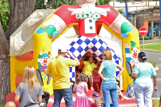 Children enjoy a bouncy castle as Wiesbaden celebrates its outstanding Army Community Service and staff members.
