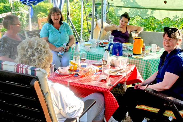Members of the Wiesbaden Kontakt Outreach German-American friendship club share a laugh during a barbecue.
