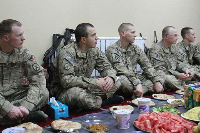 U.S. Army Soldiers assigned to 2nd Security Forces Assistance Brigade listen to Brig. Gen. Mohammad Jasim, Afghan chief of the National Directorate of Security for Paktika Province, explain the meaning of Ramadan and the Iftar meal during a dinner held Aug. 2 at the NDS building near Forward Operating Base Rushmore. Iftar is one of the religious observances of Ramadan, and it is often done as a community, with people gathering to break their fast together. Traditionally, three dates are eaten to break the fast in emulation of the prophet Muhammad, who broke his fast in this manner.