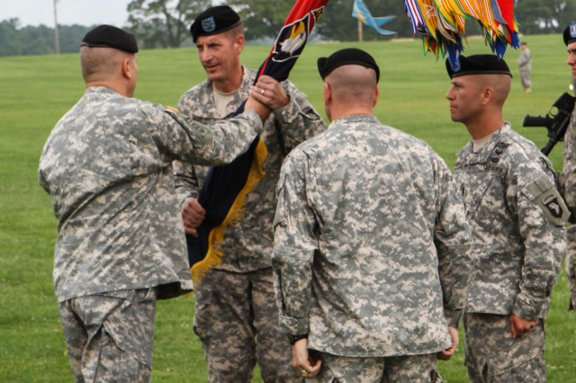 FORT CAMPBELL, Ky., - Brig. Gen. Mark Stammer, the Senior Commander of the 101st Airborne (Air Assault) and Fort Campbell, passes the 3rd Brigade Combat Team colors to Col. J.B. Vowell, the incoming Commander of 3BCT, during a change of command ceremony, August 1, 2013. The passing of the colors signifies the outgoing commander relinquishing authority over the troops so the incoming commander can assume command over the Soldiers. The colors were passed to Gen. Stammer by Col. R.J. Lillibridge, the outgoing commander of 3BCT. (Photo by U.S. Army Spc. Brian Smith-Dutton 3BCT Public Affairs)