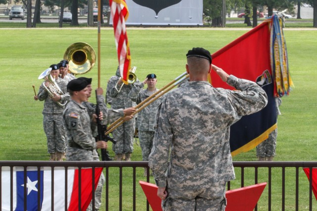 """FORT CAMPBELL, Ky., Col. J.B. Vowell, Commander of 3rd Brigade Combat Team """"Rakkasans,"""" 101st Airborne Division (Air Assault), salutes the U.S. flag during the pass and review portion of the 3BCT change of command ceremony, August 1, 2013. Col. Vowell assumed command over the Brigade Combat Team from Col. R.J. Lillibridge, the outgoing commander of 3BCT. (Photo by U.S. Army Spc. Brian Smith-Dutton 3BCT Public Affairs)"""