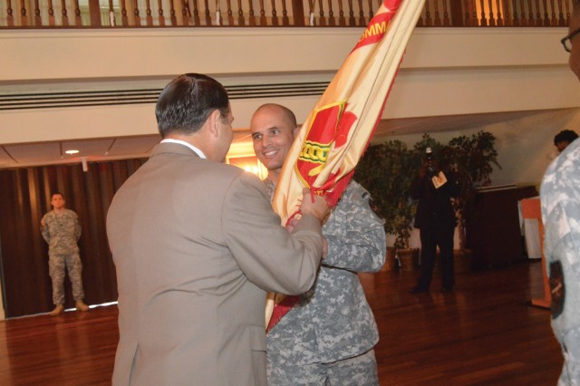 Col. Paul K. Brooks, incoming garrison commander, is handed the garrison flag by Davis D. Tindoll Jr., director, Atlantic Region, U.S. Army Installation Management Command, during a change of command ceremony Aug. 1 at the Lee Club.