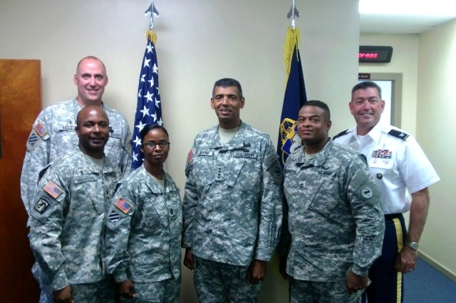 FORT SHAFTER, Hawaii - Pictured with Brooks are Chaplain (Maj-P) Bill Killough (back left), Chaplain (Lt. Col.) Eric Jackson (front left), Sgt. Maj. Cassandra Tribune (left center), Sgt. 1st Class Arthur Washington (right center) and Command Chaplain (Col.) Mike Dugal (far right).