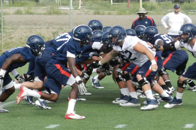 University of Arizona football players begin a scrimmage during Saturday morning's practice. The Wildcats held two practice sessions last weekend during their training camp on Fort Huachuca.