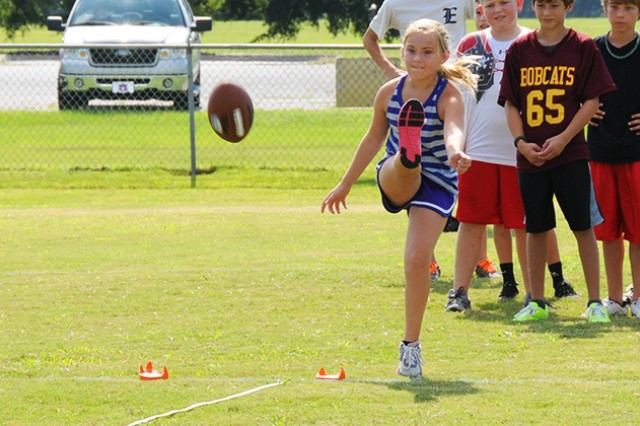 Kyla Tynan, girls 10-11 year-old winner, kicks the ball during the NFL Punt, Pass & Kick competition at the youth football field Aug. 10.