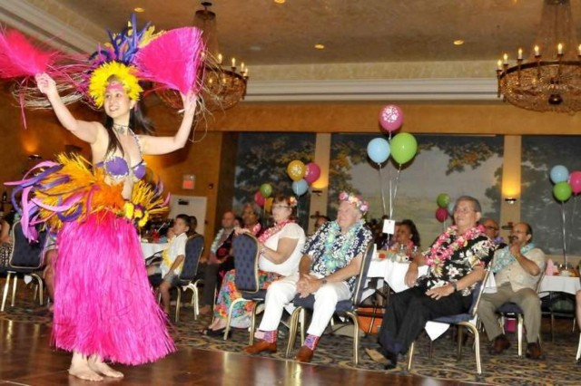 A Polynesian dancer entertains a gathering of Fort Myer Officers Club members the evening of Aug. 9 in the club's Koran Room. A troupe of South Pacific entertainers performed an hourlong program featuring native dance and a fireknife demonstration.