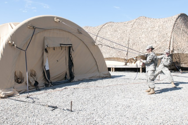 Setting up an air-supported tent