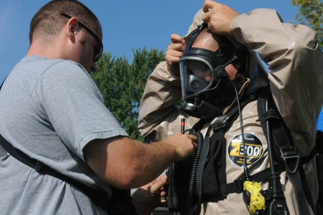 Soldiers with the 53rd Civil Support Team, Indiana National Guard, Joint Force Headquarters Ind., check their radio equipment before a route reconnaissance mission, Aug. 12, 2013, during the Vibrant Response 13-2 exercise at the Muscatatuck Urban Training Center, Ind.