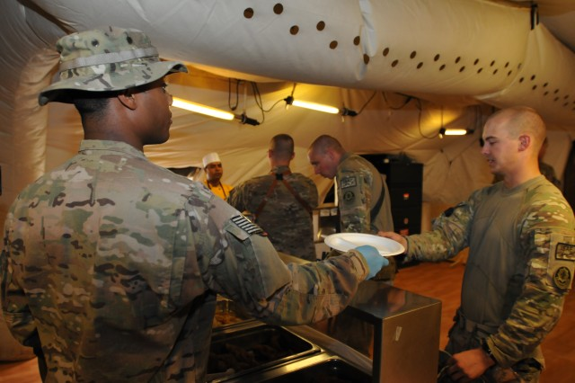 U.S. Army Pfc. Shaquille Hunter, a food service specialist with 1st Squadron, Combined Task Force Dragoon, prepares to serve a meal to troops Aug. 13, 2013 at Forward Operating Base Zangabad, Afghanistan. Hunter helps to provide three hot meals a day to soldiers currently assigned to the base. (U.S. Army Photo by Spc. Joshua Edwards)