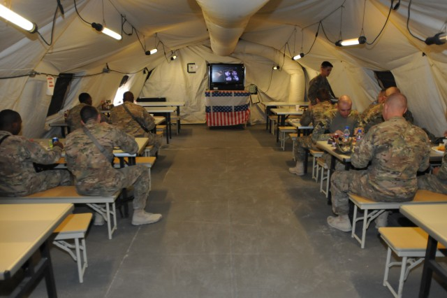 U.S. Army Troops with 1st Squadron, Combined Task Force Dragoon, eat hot food at a dining facility Aug. 13, 2013 at Forward Operating Base Zangabad, Afghanistan. Troops currently assigned to the fob receive three hot meals a day. (U.S. Army Photo by Spc. Joshua Edwards)
