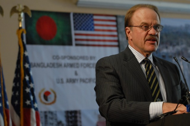 Ambassador Dan Mozena, U.S Embassy, Dhaka, emphasizes the importance of disaster preparedness and sets the tone of collaboration while addressing members of U.S. and Bangladesh military, government, and civil organizations during the 2013 Pacific Resilience Disaster Response Exercise & Exchange, or DREE, opening ceremony, Aug. 18, 2013, in Dhaka, Bangladesh. The four-day DREE, led by the U.S. Army Pacific and Bangladesh Government and Armed Forces Division, is a civil-military disaster preparedness and response initiative featuring table-top and field training exercises focused on post-earthquake command and control, urban search and rescue, engineering capacity, and debris management.