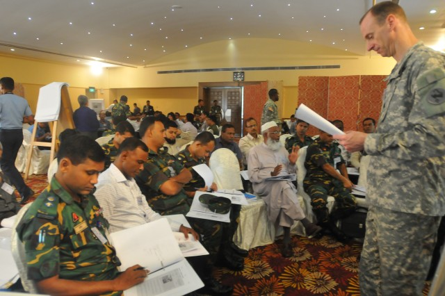 Lt. Col. Glenn Donelin, a U.S. Army Pacific civil affairs officer, facilitates discussion between members of the Bangladesh Armed Forces Division and other Bangladesh civil and government organizations, during a table-top exercise involving an earthquake scenario as part of the opening day of the 2013 Pacific Resilience Disaster Response Exercise & Exchange, or DREE, Aug. 18, 2013, in Dhaka, Bangladesh. The four-day DREE, led by the U.S. Army Pacific and Bangladesh Government and Armed Forces Division, is a civil-military disaster preparedness and response initiative featuring table-top and field training exercises focused on command and control, urban search and rescue, engineering capacity, and debris management.