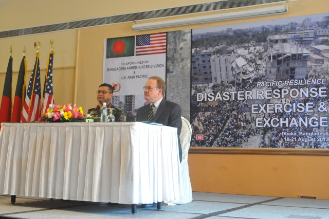 Ambassador Dan Mozena (right), U.S Embassy, Dhaka, joins Lt. Gen. Abu Belal Mohammad Shafiul Haque, the Bangladesh Armed Forces Division's principal staff officer, as the key speakers during the 2013 Pacific Resilience Disaster Response Exercise & Exchange, or DREE, opening ceremony, Aug. 18, 2013, in Dhaka, Bangladesh. The four-day DREE, led by the U.S. Army Pacific and Bangladesh Government and Armed Forces Division, is a civil-military disaster preparedness and response initiative featuring table-top and field training exercises focused on post-earthquake command and control, urban search and rescue, engineering capacity, and debris management.